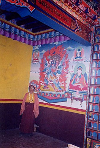 Karma Thinley Rinpoche in same shrineroom beside painting of Vajrakilaya and true likeness of Chogyur Lingpa