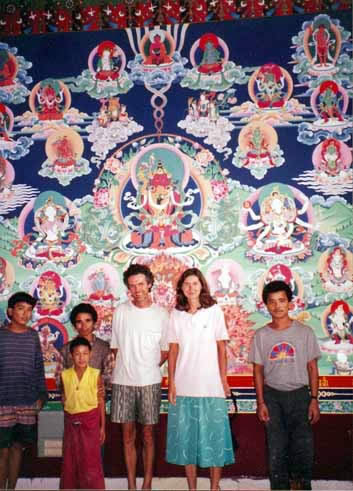 Rinpoche's assistant with his wife and the artist in front of Amitayu mandala